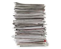 Newspapers stack isolated on white background, inclusive clipping path without shade. Royalty Free Stock Images