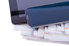 Newspapers, Tablet and Smart Phone Stock Image