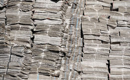 Newspapers in warehouse. Stored newspapers isolated in warehouse Stock Photo