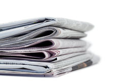 Newspapers on a white background Stock Photos