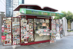 Newsstand. Newspaper stand in Shanghai China. Outside a newspaper and magazines kiosk with international and national press royalty free stock image