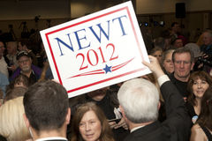 Newt holds a supporters sign. Stock Images