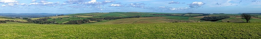 Newtimber Hill. An iron age  tumulus and part of the South Downs in Sussex, England. It is close to the long distance footpath, the South Downs Way. The view Royalty Free Stock Photos