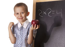 Newton. Boy preschooler standing at the blackboard with Apple in hand as Newton Stock Photography