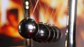 Newton Cradle Bouncing Chrome Balls stock footage