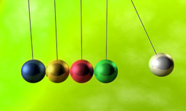 Newton cradle pendulums. A colorful newton cradle pendulums Royalty Free Stock Images