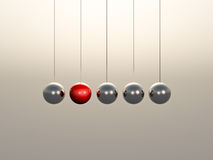 Newton Cradle spheres. With soft glowing light Royalty Free Stock Photography