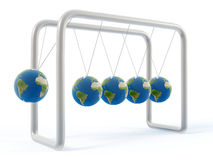 Newton earth cradle. Chrome Newton's cradle with balancing earth spheres Stock Photography