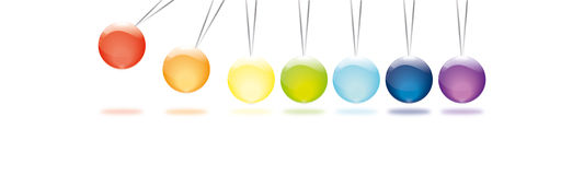 Newton pendulum in rainbow colors. Against white background Stock Photography