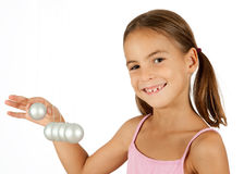 Newton's cradle. Young girl holding a pendulum ball Royalty Free Stock Image