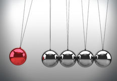 Newton's cradle. With one red ball Royalty Free Stock Photography