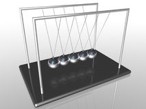 Newton's Cradle balls. Newton's Cradle swinging balls device Royalty Free Stock Image