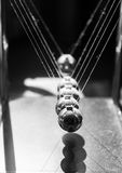Newton's cradle. Black and white closeup of Newton's cradle Stock Photo