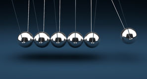 Newton's Cradle. On blue background Stock Photography