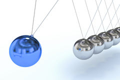 Newton's Cradle with Blue Sphere, Individuality Royalty Free Stock Photography