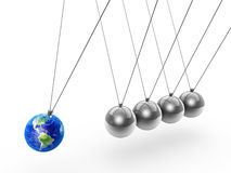Newton's cradle and earth Stock Image