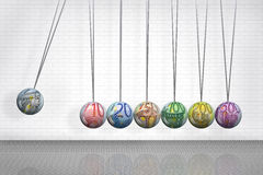 Newton's Cradle with Euro Symbol Balls. Newton's cradle or executive clicker with euro currency denominations in the balls Royalty Free Stock Image