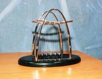 Newton's cradle. Newton's Pendulum. Balls beat. Set of metal balls Stock Images