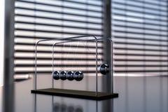Newton`s cradle pendulum Stock Photo