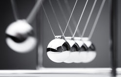 Newton's cradle. Physics concept for action and reaction or cause and effect Royalty Free Stock Photography