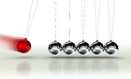 Newton's Cradle with red ball Royalty Free Stock Photos
