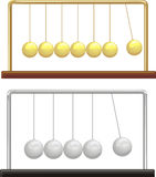 Newton`s cradle - silver & gold Royalty Free Stock Photo