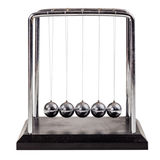 Newton's cradle. A small Newton's cradle isolated over a white background royalty free stock photos