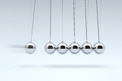 Newton`s Cradle, Time cradle. Stock Photos