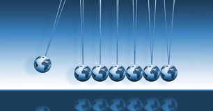Newton's Cradle with World Globes. Newton's cradle is a device that demonstrates conservation of momentum and energy via a series of swinging spheres. This blue Royalty Free Stock Photography