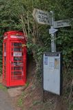 Improvised book exchange at a crossroads in Devon UK. NEWTON ST CYRES, ENGLAND - AUGUST 25, 2017: A vintage public telephone box housing books for exchange Stock Photo