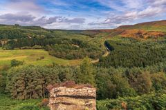 Newtondale, seen from the Levisham Moor, North Yorkshire, England, UK. Near Levisham, North Yorkshire, England, UK: September 13, 2018: A train of the historic royalty free stock images