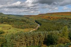 Newtondale, seen from the Levisham Moor, North Yorkshire, England, UK. Near Levisham, North Yorkshire, England, UK: September 13, 2018: A train of the historic stock image