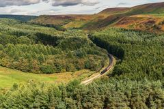Newtondale, seen from the Levisham Moor, North Yorkshire, England, UK. Near Levisham, North Yorkshire, England, UK: September 13, 2018: A train of the historic royalty free stock photography