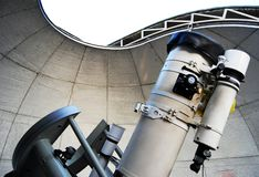 A newtonian telescope. Under a dome royalty free stock photo