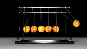Newtons Cradle - Apples on Black. Newtons Cradle made with apple in motion Royalty Free Stock Image
