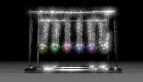 Newtons Christmas Cradle. Newtons cradle using Christmas ornaments Stock Photo