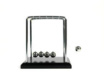 Newtons Cradle. Isolated against a white background Royalty Free Stock Images