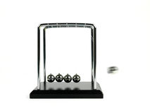 Newtons Cradle. Isolated against a white background royalty free stock photography