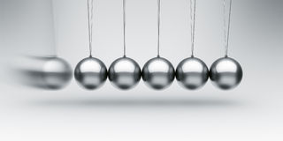 Newtons cradle Stock Photos