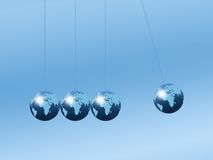 Newtons Cradle. Using world globes on a plain background Royalty Free Stock Photos