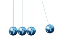 Newtons Cradle. Using world globes on a plain background Royalty Free Stock Photo