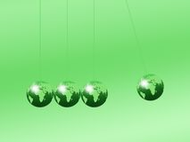 Newtons Cradle. Using world globes on a plain background Royalty Free Stock Photography