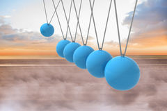 Newtons cradle above beach Stock Images