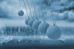 Newtons cradle above city Stock Images