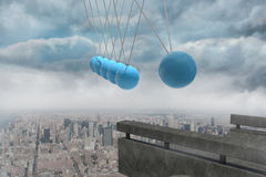 Newtons cradle above city Stock Photos