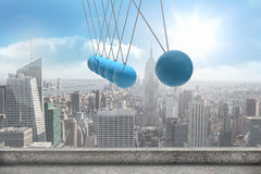 Newtons cradle above city Royalty Free Stock Photos