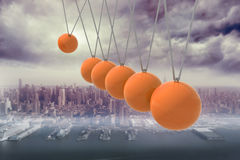 Newtons cradle above city Stock Photography