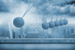 Newtons cradle above city Stock Image