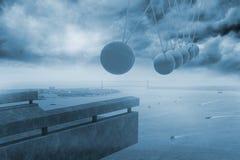 Newtons cradle above coastline Stock Images