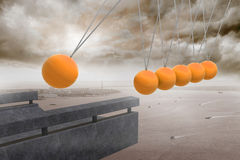 Newtons cradle above coastline. Under cloudy sky Stock Images